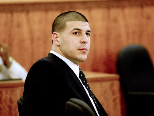 Former New England Patriots football player Aaron Hernandez listens to testimony during his trial in Fall River, Mass., Monday, April 6, 2015. Hernandez is accused of killing Odin Lloyd in June 2013.