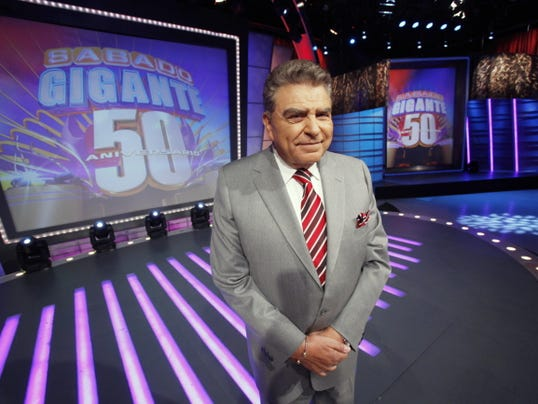 """FILE- In this photo taken on Feb. 3, 2012, Chilean born host of the Univision network variety show """"Sabado Gigante,"""" Mario Kreutzberger, popularly known as Don Francisco, poses on the set of his show in Miami. Univision announced Friday, April 17, 2017 that the beloved show """"Sabado Gigante"""" will end on Sept. 19, 2015 after 53 years on the air."""