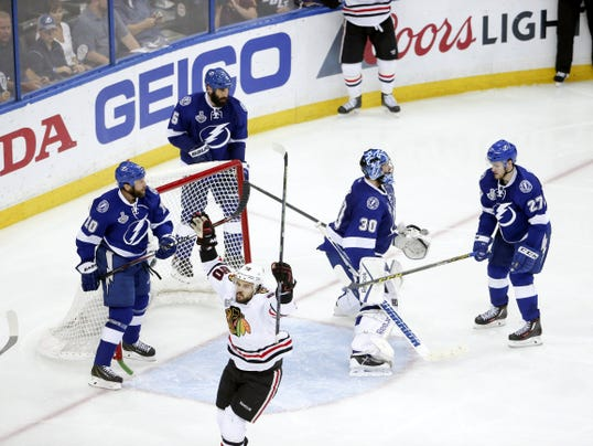 Chicago's Antoine Vermette (80) celebrates his goal in the third period against the Tampa Bay Lightning in Game 5 of the Stanley Cup final at Amalie Arena in Tampa, Fla., on Saturday. The Blackhawks won, 2-1, to take a 3-2 series lead.