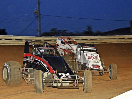 Chris Windom, front, tries to hold off the challenges of Robert Ballou (12) and Trevor Kobylarz, rear, during the  Eastern Storm USAC race on Saturday at Port Royal. Ballou won all three of the Storm races last weekend.