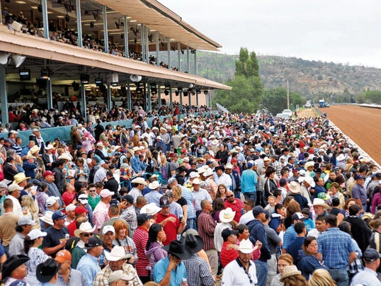 Ruidoso Valley Chamber of Commerce members welcome racing fans, trainers, owners and jockeys to the 2015 racing season.