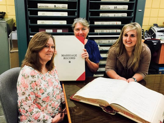 Lincoln County Clerk staff working on the preservation of aging county documents are from left, Charlotte Emmons, Diane Shoemaker and Allysanne Huey.