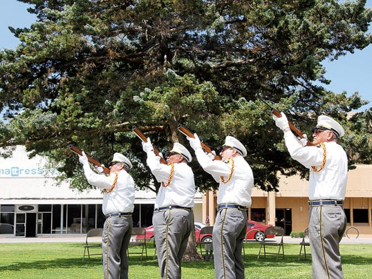 """SARAH MATOTT - CURRENT-ARGUS   The Carlsbad Veterans Honor Guard fired three vollies in honor of fallen military at the """"Welcome Home"""" ceremony for local Vietnam Veterans on Saturday."""