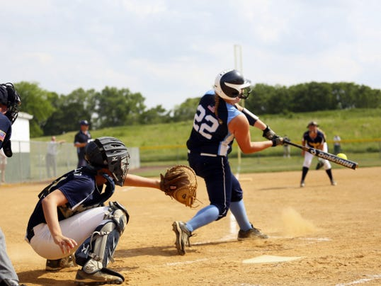 Conrad Weiser's Brianna Pichler, right, makes contact with the ball in front of Greencastle-Antrim catcher Katie Gelsinger on Thursday. The Blue Devils lost an eight-inning affair, 2-1, in the District 3 Class AAA consolations.
