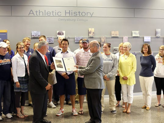 Gettysburg College men's lacrosse coach Hank Janczyk, fron left, is presented with an honorary citation from state Rep. Will Tallman, front right, on Thursday, June 4, 2015. Janczyk was honored for by the state House of Representatives for earning his 400th career victory this season. Courtesy Gettysburg Athletic Communications