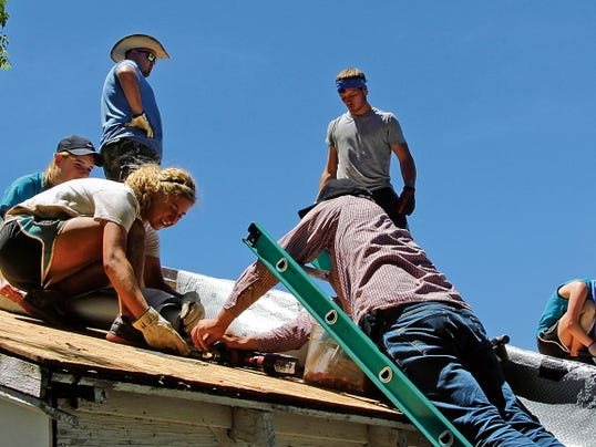 Photo Courtesy of Ed Gonzalez.   Volunteers work to repair a house's roof during Mission Carlsbad in 2014. This year's Mission Carlsbad kicks off on June 1, organizers say that over 250 people are signed up to volunteer.