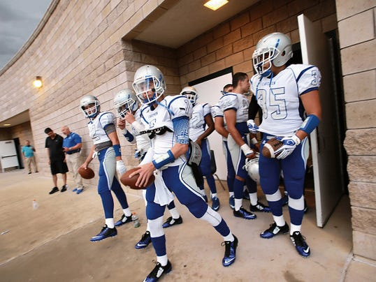 VICTOR CALZADA-EL PASO TIMES Carlsbad players wait eagerly at the lockerroom door to take the field Friday.