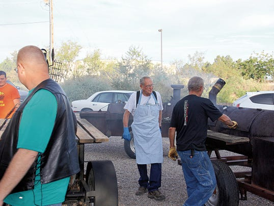 Courtesy Photo   Members of the First United Methodist Church Men's Club keep watch over the smokers containing the mesquite top round beef that will be served during the 35th annual Duck Days BBQ from 11 a.m. to 2 p.m. Saturday at the church, 1020 S. Granite St.