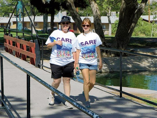 Janice Gonzales and Leticia Soto walk in CARE's second annual Jubilee of Life Walk in 2014 at Young Park.