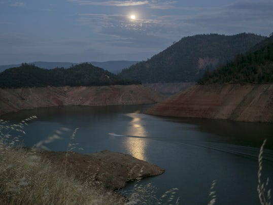 A blue moon rises over the confluence of the South and Lower Forks of the Feather River, feeding into Lake Oroville below the Bidwell bridge on July 30, 2015.  (Robert Gauthier/Los Angeles Times/TNS)