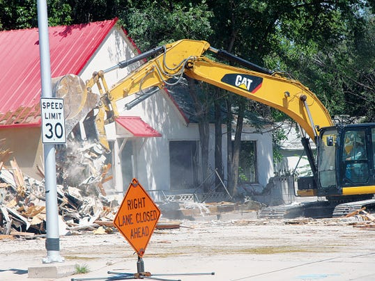 KATIE ENGLAND -- CURRENT ARGUS   Las Cruces-based Renegade Construction is demolishing several houses at the corner of Canal Street and Church Street, to make room for the new CVS Pharmacy.
