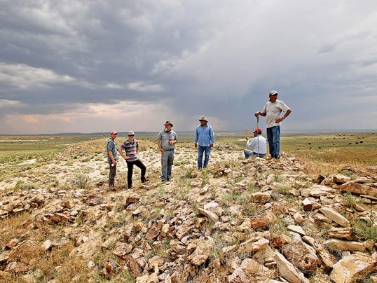 A tour group led by Paul Reed, third to the right, pauses Tuesday at a ruin located on top of a hill at Pierre's Ruins.