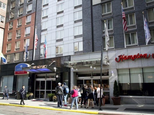 Three hotels, from left, Holiday Inn Express and Candlewood Suites, both Intercontinental Hotels Group brands, and Hampton Inn, a Hilton brand, share the same building on West 39th Street in New York.