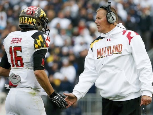 In this Nov. 1, 2014 file photo, Maryland head coach Randy Edsall, right, greets quarterback C.J. Brown as he returns to the sideline after throwing a touchdown pass during a game against Penn State in State College, Pennsylvania. Edsall is a Susquehannock High School graduate.