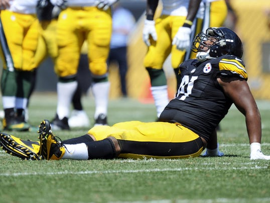 Pittsburgh Steelers defensive end Stephon Tuitt is injured in a preseason game against Green Bay Packers on Sunday in Pittsburgh.