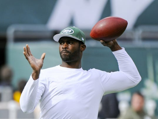 Former New York Jets quarterback Michael Vick, seen here warming up before a game against the Pittsburgh Steelers, is now a member of the Steelers after agreeing to a one-year contract. He will be a backup behind Ben Roethlisberger.