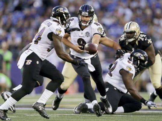 Baltimore Ravens' quarterback Matt Schaub (8) hands the ball off to running back Lorenzo Taliaferro (34) during the first half of Thursday's preseason game against the New Orleans Saints in Baltimore. The Ravens won, 30-27.