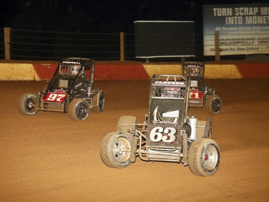 Bryan Clauson (No. 63), races with Rico Abreu (No. 67) and Chris Bell (No. 71) for the lead of the USAC/ARDC Midgets race at Lincoln Speedway on Wednesday night. Abreu went on to win for the second straight night.