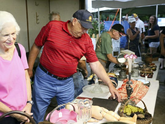 Attendees browse items for auction Saturday morning during the auction of Marion Harbaugh's estate outside of the Harbaugh's Biglerville home at 161 West York St.