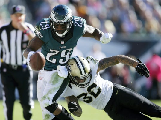 Philadelphia's DeMarco Murray, left, rushes against New Orleans' Kenny Vaccaro during the second half of Sunday's game. Murray rushed for one touchdown in the Eagles' 39-17 victory.