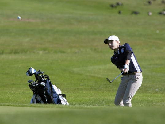 Chambersburg's Mary Kate Norcross chips onto the green during the District 3 golf tournament at Briarwood West Golf Course on Saturday. Norcross bettered her score by six strokes from the day before, but did not advance to regionals.