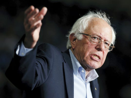 In this photo taken Oct. 3, 2015, Democratic presidential candidate, Sen. Bernie Sanders, I-Vt,  speaks during a campaign rally in Springfield, Mass. The state where Hillary Clinton and Sanders will meet to debate on Tuesday, Oct. 13, for the first time is evidence of why she's still the front-runner. Clinton has staff organizing on the ground for months in Nevada and they know how to navigate the state's baroque caucus system. (AP Photo/Michael Dwyer)
