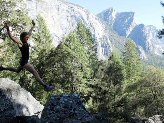 Naomi Plasterer leaps to a rock in the Rocky Mountains of Colorado. She competed in the Nolan's 14 event, which involves running and rock climbing, despite a broken foot.
