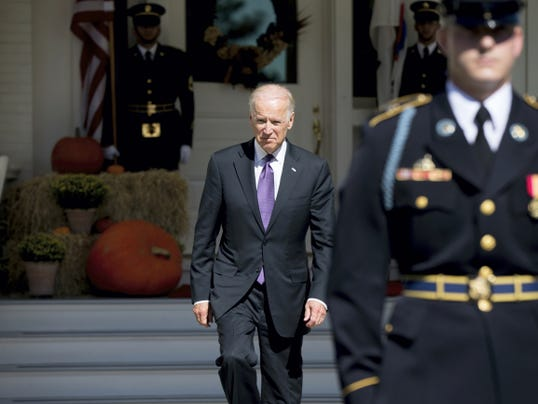Vice President Joe Biden arrives to greet South Korean President Park Geun-hye as she arrives for lunch at the Naval Observatory, Thursday, Oct. 15, 2015, in Washington. (AP Photo/Andrew Harnik)