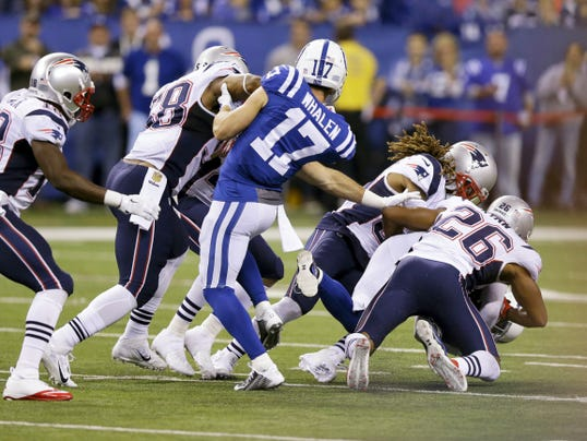 Indianapolis Colts wide receiver Griff Whalen (17) watches as Indianapolis Colts free safety Colt Anderson (32) is tackled New England Patriots running back James White (28) on a fake punt attempt in the second half of Sunday's game in Indianapolis.