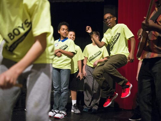 Seventh-graders play drums and dance on stage with the band B-Tropical. Hundreds of boys attended the YMCA's annual Young Men's Leadership Conference, which focused on the topics of bullying and leadership, at the York Learning Center on Tuesday.
