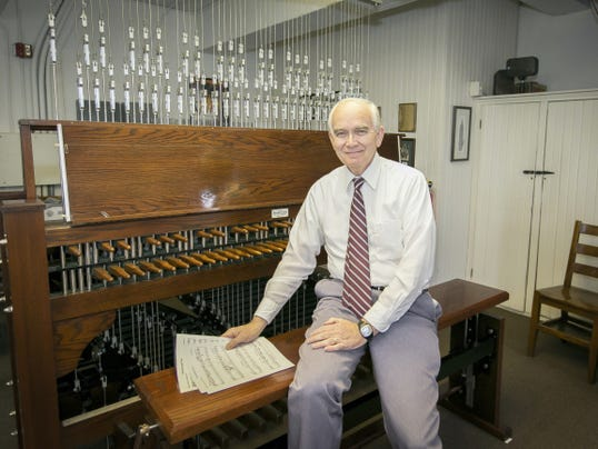 James Brinson sits at the Swoope Carillon at Mercersburg Academy.