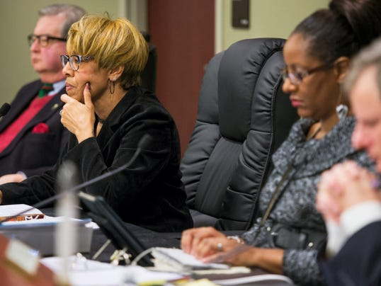 York City Council President Carol Hill-Evans, left, listens to public comments during a York City Council meeting focused on passing a city budget on Tuesday. Hill-Evans voted against the final balanced budget bill, which passed 3-2.