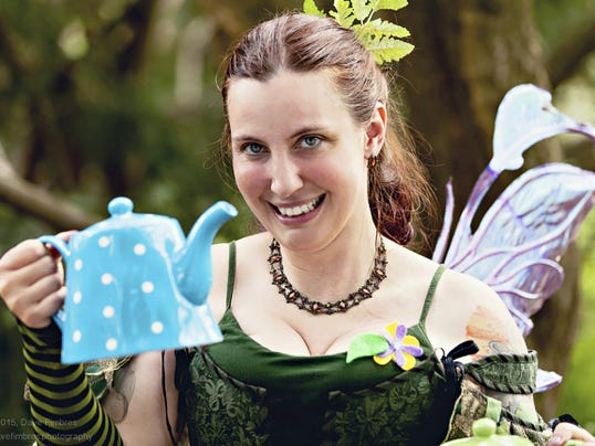 Chrissy offers tea to young attendees. Fairie tea is served in the Tea Tent every day of the Fairie Festival. Submitted