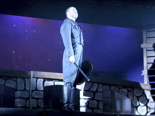 "Adam Clough plays police inspector Javert in the Dutch Apple Dinner Theatre's production of ""Les Miserables."" Clough said the emotional ride of the character is a ""draining experience."""