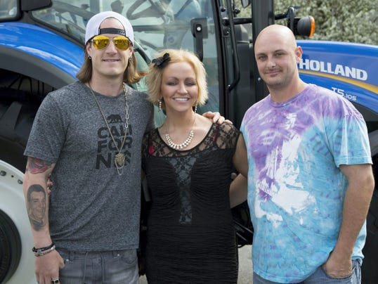 "Lindsay Tritle, grand winner of New Holland's national ""Voice of the Next Generation"" music video contest, poses May 2 with country music star Tyler Hubbard, left, and Tritle's fiance Ryan Frazer."
