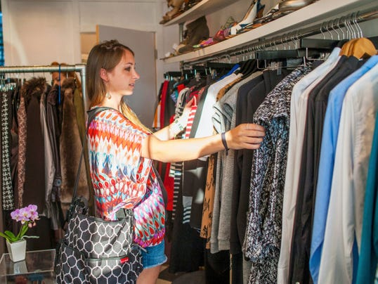 Kara Johansson flips through the racks on display at Arthur & Daughters, including items from a new collection called Lobo Mau by Philadelphia designer Nicole Haddad during last year's Boutique Week.