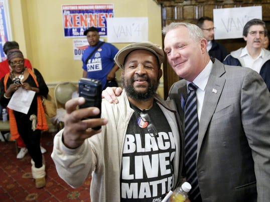Philadelphia Judge Kevin Dougherty, a Democratic candidate for Pennsylvania Supreme Court poses for a selfie with a supporter on election day, Tuesday, Nov. 3, 2015, in Philadelphia. (AP Photo/Matt Rourke)
