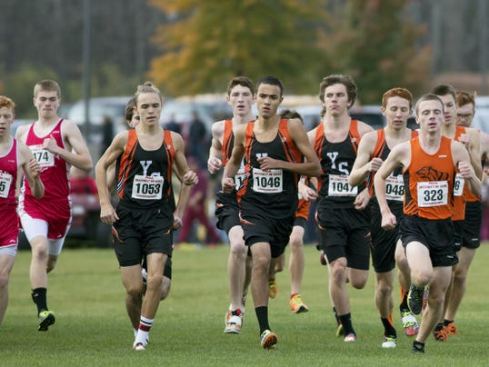 The York Suburban boys' cross country team gets off to a nice start at the District 3 Class AA cross country championships at Big Spring High School on Saturday. The Trojans' top five runners placed in the top 15 overall to bring home the program's third straight district title.