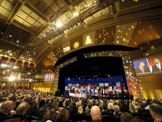 Chris Christie and Bobby Jindal are seen on the large monitors next to the stage as Rick Santorum, Chris Christie, Mike Huckabee, Bobby Jindal appear during Republican presidential debate at Milwaukee Theatre, Tuesday, Nov. 10, 2015, in Milwaukee. (AP Photo/Jeffrey Phelps)