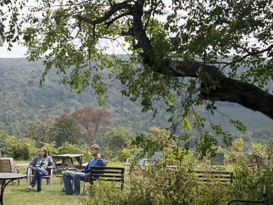 Renee and Justin Holoviak of Chambersburg listen to Matt Miskie at Reid's Orchard & Winery.