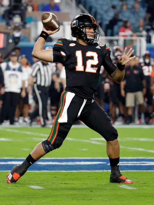 Miami quarterback Malik Rosier (12) looks to pass, during the first half of the Orange Bowl NCAA college football game against Wisconsin, Saturday, Dec. 30, 2017, in Miami Gardens, Fla. (AP Photo/Lynne Sladky)