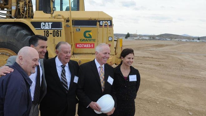 Sparks Mayor Geno Martini, left, Gov. Brian Sandoval, Reno Mayor Bob Cashell, Dermody Properties Chairman and CEO Michael Dermody and Melanie Gangel, vice president of PCCP, pose for a photo during Tuesday's LogistiCenter 395 groundbreaking.