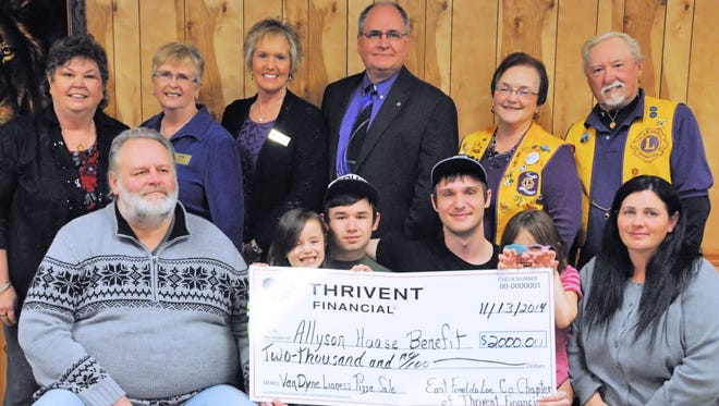The Thrivent check presentation included, from front left, father Mike Haase; sister Katie Haase; brothers Kyle Jolin and Aaron Kitts; Ally Haase; and mother Linda Haase. Back left: Jo Wendorff, Sue Repp and Lisa Freiberg, all Thrivent board members); Larry Poch, Thrivent Financial rep.; Barb Leichtfuss, Van Dyne Lioness president; and Wally Schmid, Van Dyne Lions president.
