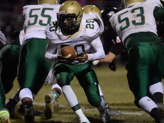 Acadiana quarterback Myles Hutchinson looks to hand off the ball while playing against Parkway in the Class 5A second round playoff game.