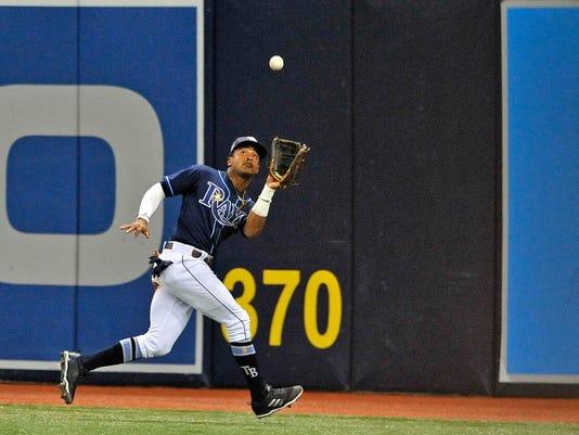 Mariners_Rays_Trade_Baseball_37111.jpg