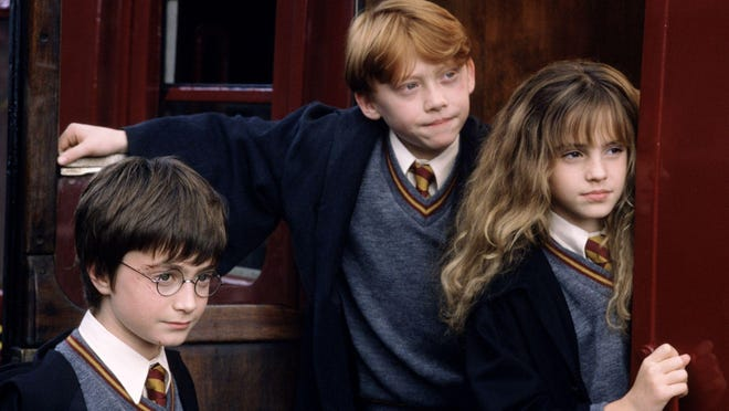 """Daniel Radcliffe (left), Rupert Grint and Emma Watson star in """"Harry Potter and the Sorcerer's Stone."""" All eight """"Harry Potter"""" films, as well as """"Fantastic Beasts and Where to Find Them,"""" return to theaters Aug. 31-Sept. 6."""