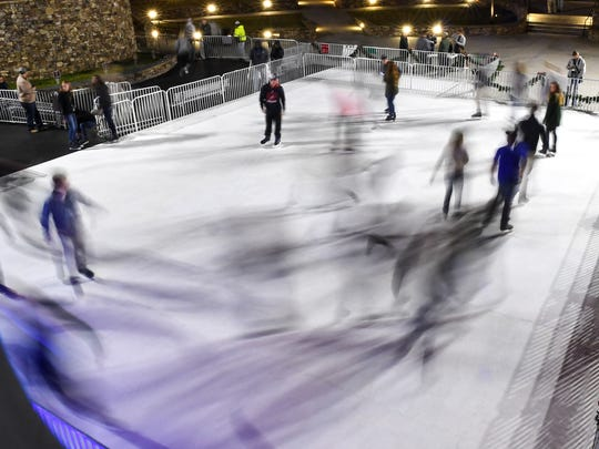 Anderson University students test out the Holiday Ice at Carolina Wren Park in downtown Anderson on Monday night. The City of Anderson allowed all Anderson University students to try out the rink Monday, a test run for the 5 p.m. Wednesday opening night.
