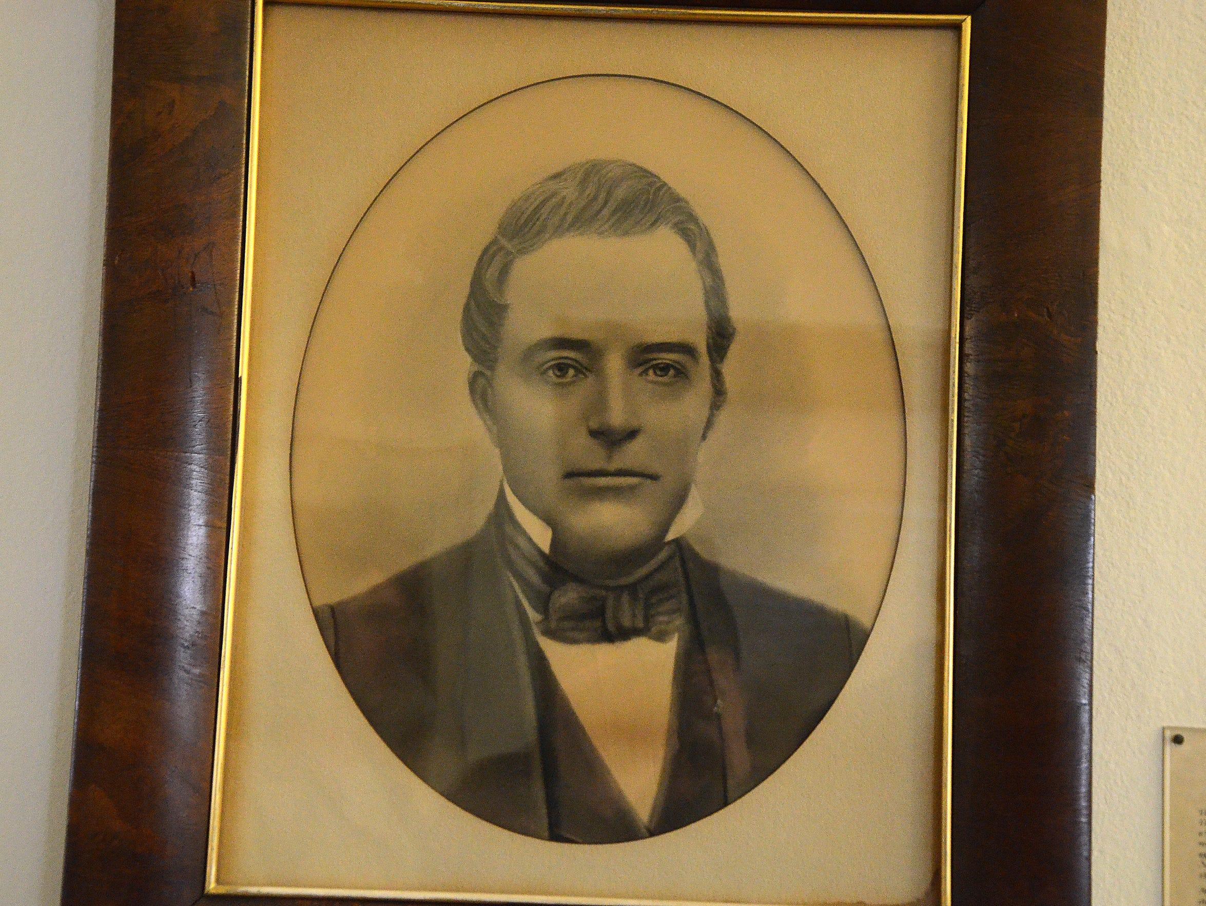 A portrait of Elijah Pendill hangs in City Hall. Pendill