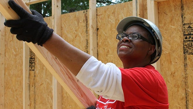 A member of the Jackson Alumnae Chapter of Delta Sigma Theta helps with the building of this house in May of this year.The dedication of the 17th Women Build house constructed by Habitat for Humanity Mississippi Capital Area (HFHMCA) will be on Thursday.