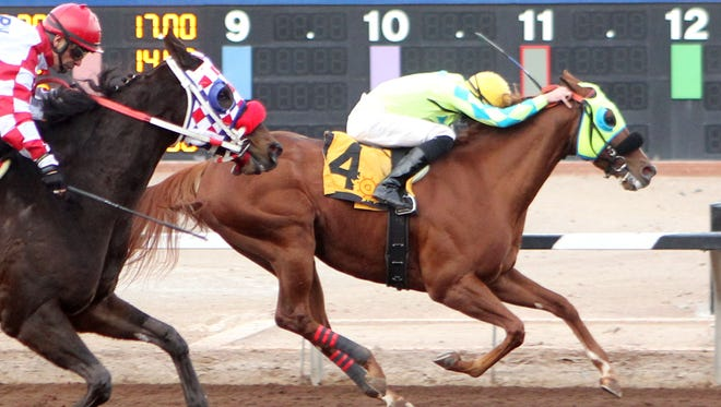 Alsono, ridden by Ry Eikleberry, repels a late rally from Forin Sea to win the $65,000 KLAQ Handicap Saturday at Sunland Park and Casino.